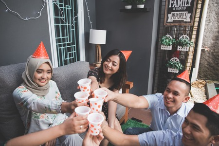 Group of friends enjoying party and cheers. celebrating and singing together Stock Photo