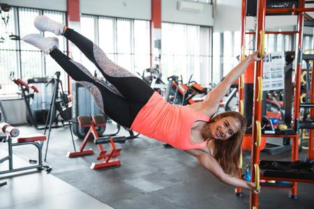 Woman doing human flag exercise