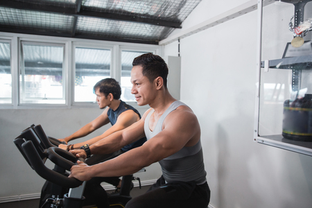 Two asian muscular male doing cardio excercises Stock Photo