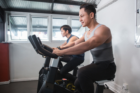 Asian muscular male doing cardio excercises