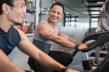 Close up view happy man meeting friend when cardio excercises
