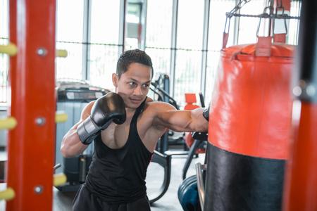Boxer doing training on a punching bag 版權商用圖片