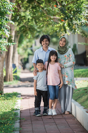 young asian muslim family