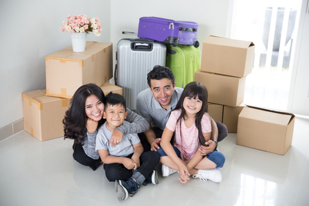 happy young family with lots of cardboard box Standard-Bild - 101144899