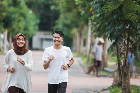 Couple runner working on exercise and warm up Stock Photo