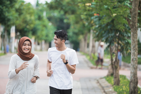 happy young asian couple exercise and warm up