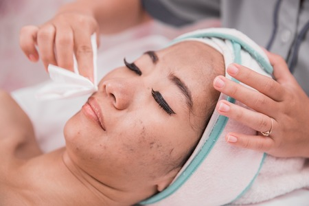 woman facial care in beauty salon and spa