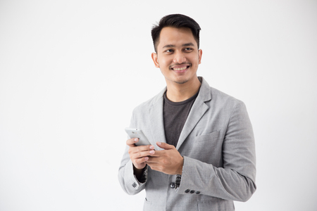 Asian Young Business with smart cell phone