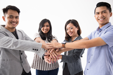 asian business people put hands together