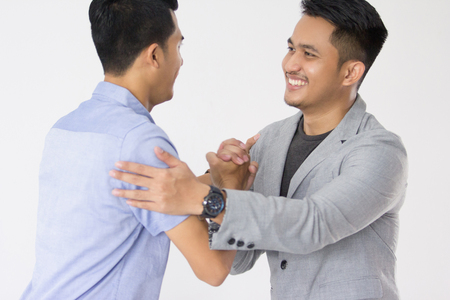 Asian Young Business shake hand Stock Photo