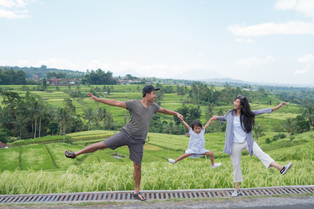 mother and daughter enjoy paddy rice field view