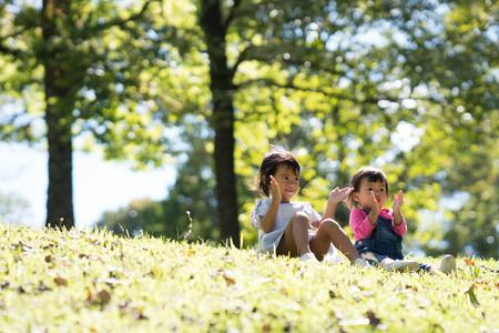 baby girls play in park Reklamní fotografie