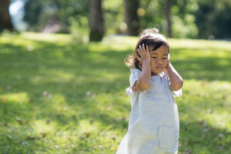 toddler frustrated cover her ears