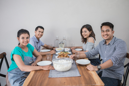 group of asian people having lunch