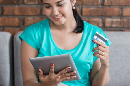 Casual woman using tablet at home