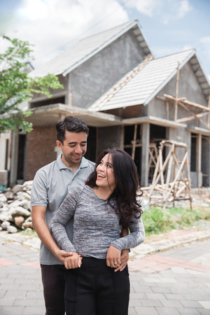 couple with their nearly finished house 写真素材