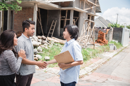 couple with the house contractor nearly finished house
