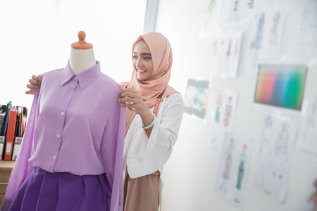 woman tailor working with mannequin Stock Photo