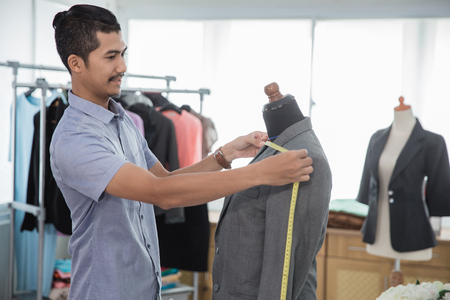 fashion designer measuring a suit Stock Photo