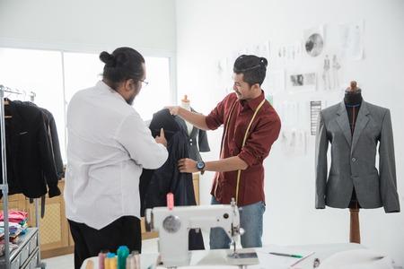 two male fashion designer discussing Stockfoto