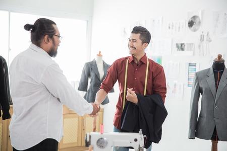 tailor with his customer talking Reklamní fotografie