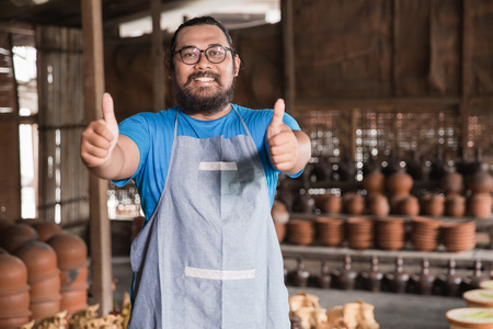 pottery maker showing thumbs up