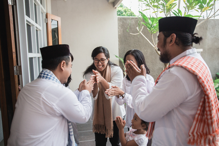 family forgiving and apologizing each other. eid mubarak Stock Photo