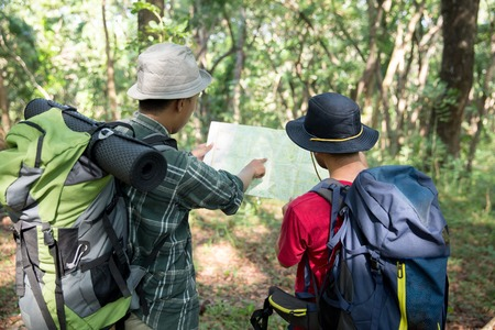 people hiker talking about the map