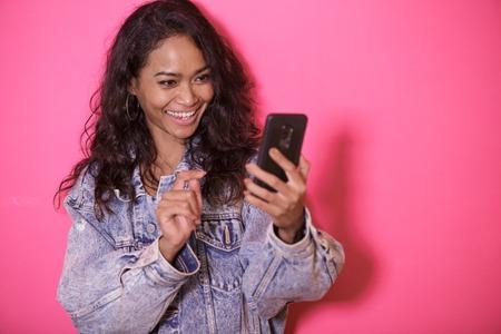 casual pretty woman taking selfies using mobile phone camera Stock Photo