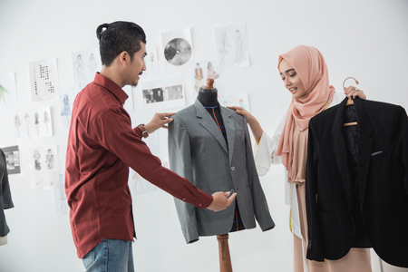 tailor and customer talking about the suit