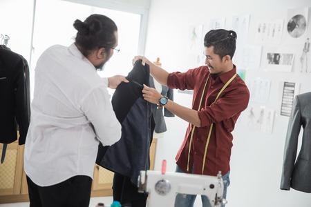 two male fashion designer discussing Reklamní fotografie