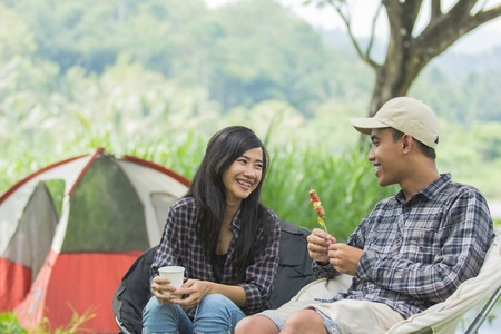 two asian couple in nature camping Stock Photo