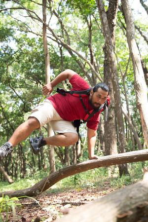 man hiker jumping crossing Stock fotó