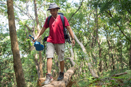 man walking on a tree while hiking Stock fotó - 103128178