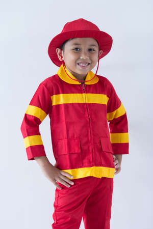 A boy pretend as a fire fighter Stock Photo