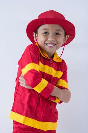 A boy uniform as a fire fighter