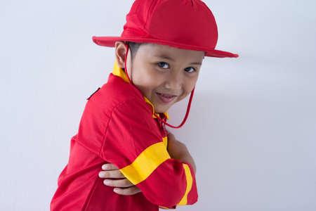 Close up little boy pretend as a fire fighter