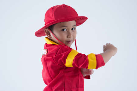 Close up a boy pretend as a fire fighter