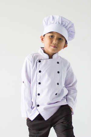 asian boy wearing chef uniform 版權商用圖片