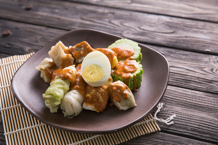siomay. traditional indonesian food with peanut sauce. dumpling