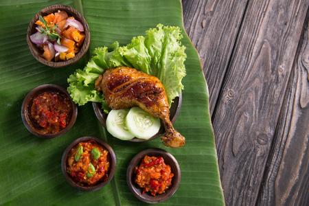 ayam penyet with various sambal or hot spicy chili sauce