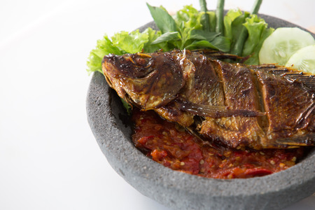 penyetan traditional indonesian food with fish served with spicy sambal