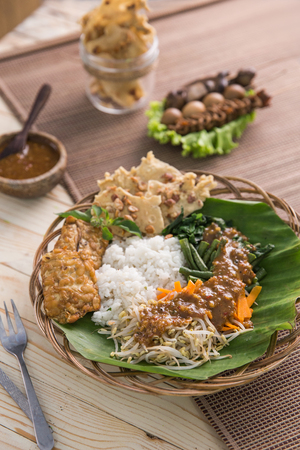 nasi pecel. vegetable with peanut sauce. indonesian tradtional food