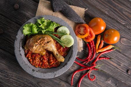 traditional fried chicken in indonesia cuisine served with sambal or chili sauce