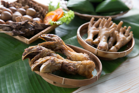 traditional indonesian culinary food. fried chicken head Stock Photo