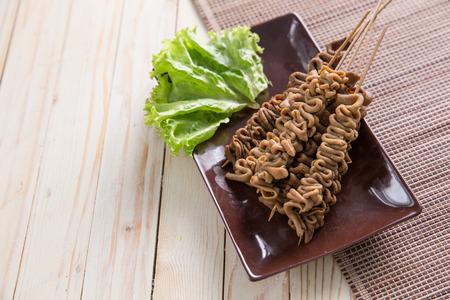 indonesian food. sate usus in close up portrait. intestines satay