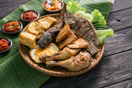penyetan. indonesian traditional cuisine. fast food served with various of hot chili sauce sambal