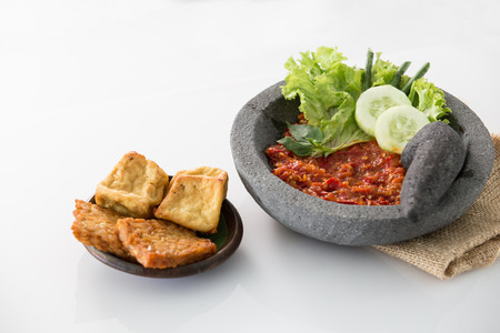 traditional indonesian culinary food. sambal and penyetan tempe tahu Фото со стока