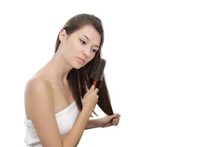 beautiful girl brushing her long hair