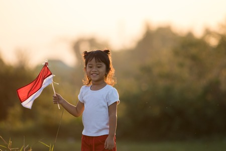 kids raising indonesian flag